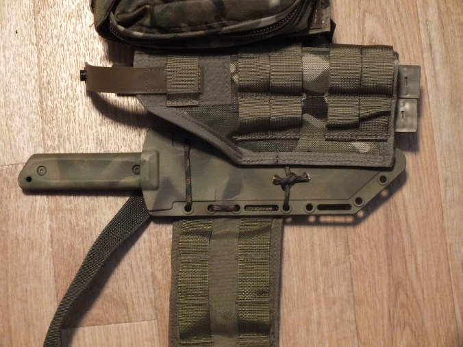 My knife on a battle belt.  It rides nicely behind my pistol holster and blowout kit.  So far, it works just fine.