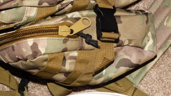 This is one of two identical MOLLE bags that run on the outside bottom of the bag. These can be moved as desired, though I'm leaving them there for the time being.